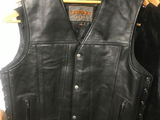 New heavy duty leather motorcycle vest with built in gun pocket on both sides