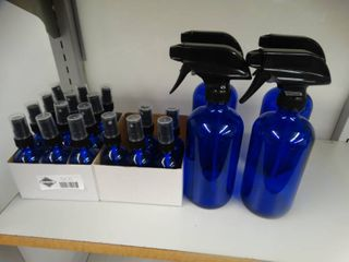 Blue glass small bottles and bigger glass spray bottles