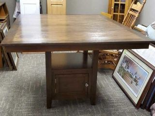 Tall pedestal dining table with storage base