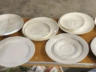 Assorted stoneware and ceramic plates