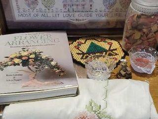 Embroidered tablecloth,glassware, decor book
