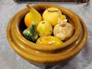 Wooden bowl with marble fruit