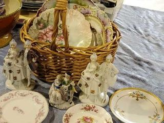 Basket of decorative plates, porcelain figurines