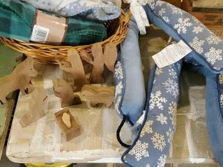 Wooden nativity, fleece blankets, draft stoppers