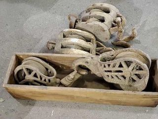 Antique pulleys, cast iron and wooden