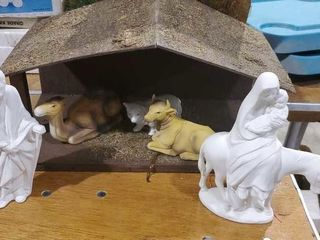 Assorted nativity pieces with creche