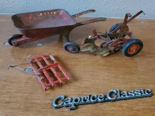 Toy tin wheelbarrow, Caprice emblem, toy plow