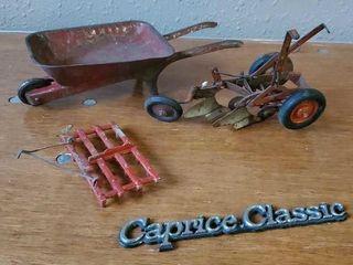 Toy tin wheelbarrow, Caprice emblem, toy plow