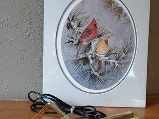Cardinal print with brass bracket light
