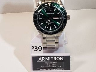 Armitron stainless steel day and date water resistant to 65  ft men s wristband watch with green face