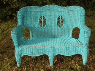Antique Wicker Outdoor Sofa with Ornate Back Design