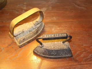 2  Antique Sad Irons  P N MFG  Co  and unmarked