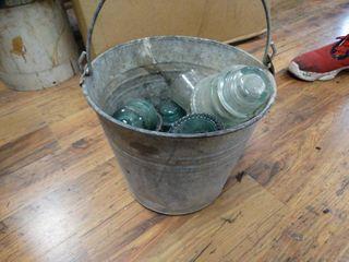 Vintage metal pail w  glass insulators