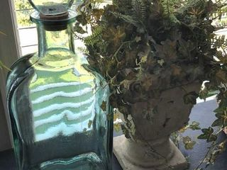 Potted Fake Plant and large Glass Bottle