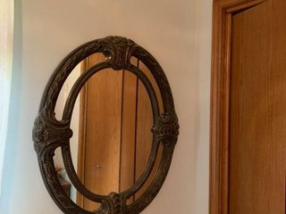 Oval mirror with brass coloring approximately 3 foot high