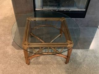 Glass and rattan round coffee table