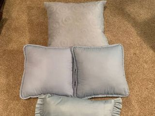 Set of four blue pillows