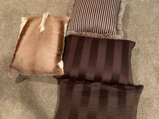 Set of four brown pillows