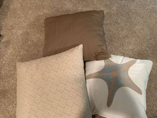 Set of three brown pillows