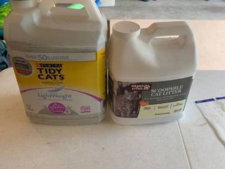 Two half used bottles of cat litter