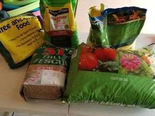 Assorted grass seed and gardening supplies