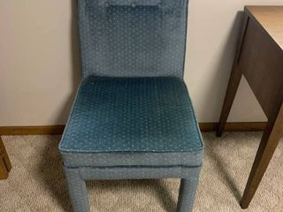 Blue upholstered rolling chair