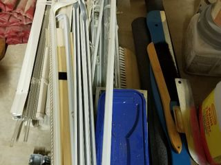 Assorted curtains  rods and wallpaper supplies