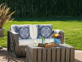 Cadence Outdoor 2 piece Acacia Wood loveseat and Coffee Table Set with Cushions by Christopher Knight Home  Retail 755 99