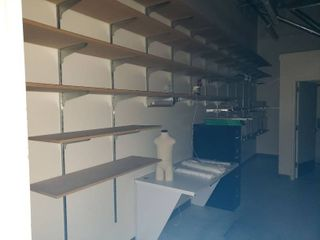 lot of wall shelving  file cabinet  manequins