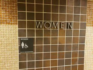 Men and women s bathroom signs