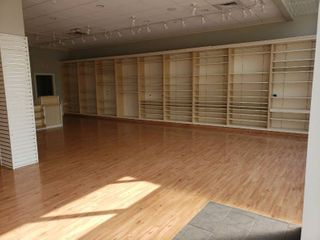 lot of wall shelving units   Yankee Candle
