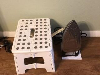 White collapsible stepstool and sunbeam steam