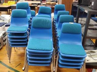 large lot of Blue Plastic Chairs