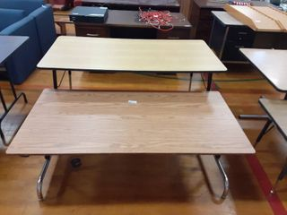 2 adjustable height tables