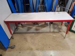 long desk with red legs