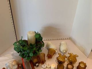 Assorted candleholders and candles