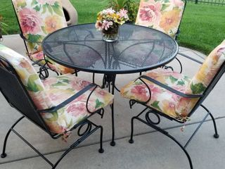 Wrought iron patio table with 4 chairs