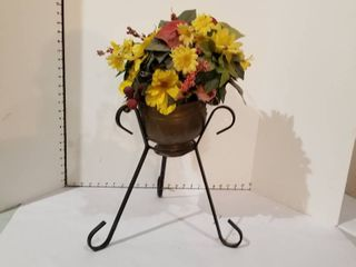 Floral decor in pot on iron stand