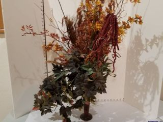Floral decor in metal stand