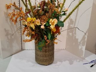 Artificial flowers in brass container