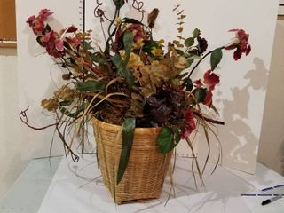 large floral arrangement in basket
