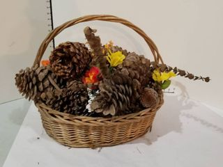 Assorted artificial flowers in large basket