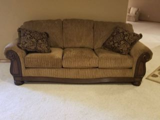 large sofa brown with wood trim  very nice   90 by 32 by 37