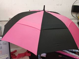 repel golf umbrella with triple layered reinforced fiberglass ribs adorned in red black and pink