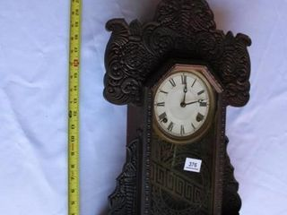 Torchlight Clock  Dark Carved wood 141 2  x 22