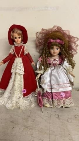 RED DRESS DOll IS PlASTIC AND PINK DRESS ID