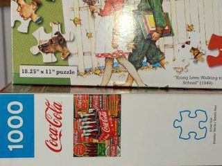 Puzzles  3 Boxes  2  1 000  and the other is 500pcs  COCA COlA and NORMAN ROCKWEll