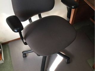 Adjustable Hon Swivel Office Desk chair on casters with Grey upholstery   Floor Mat  is cracked