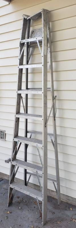 8 Ft  Aluminum Step ladders   Damage 0n Top   see pix