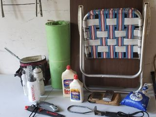 Folding Table   Chair  Cooler  Water Bottles  lighter Fluid  Saws  Charcoal starter and Hand warmers